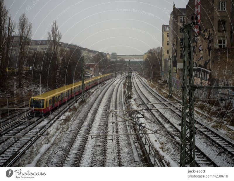 a winter day at the Ringbahn Bad weather Schönhauser Allee Prenzlauer Berg Berlin hazy Railroad system Winter Snow ring track Snowfall Traffic infrastructure