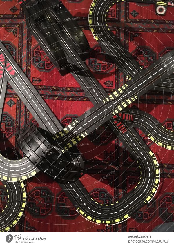 Curvaceous Model racecourse Toys cars Running swift speed Speed Street Miniature Transport Road traffic Motoring Colour photo Interior shot Carpet Pattern