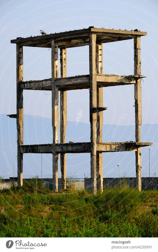Building ruin in southeastern Europe in the late afternoon Unfinished building Albania construction boom unfinished Concrete Architecture Deserted nobody