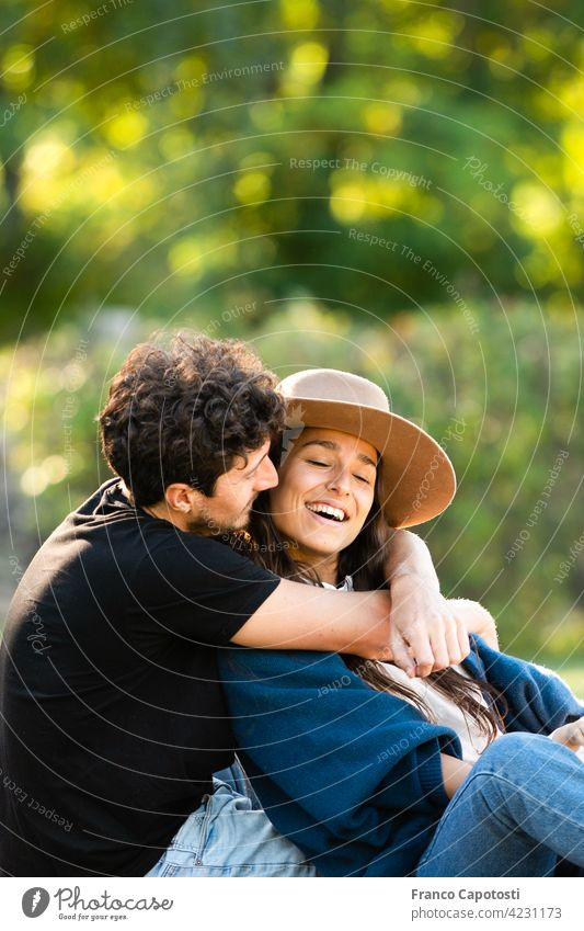 young couple loving each other in the park beautiful boyfriend casual cheerful day family female fun happiness happy laughing leisure lifestyle love man nature