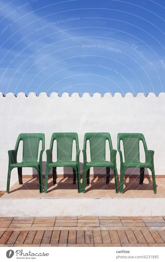 Spaces   Sitting between the chairs Chair plastic Green Roof terrace Summer Sun vacation Platform tiles Wood wooden floor Wall (building) Roofing tile Row 4