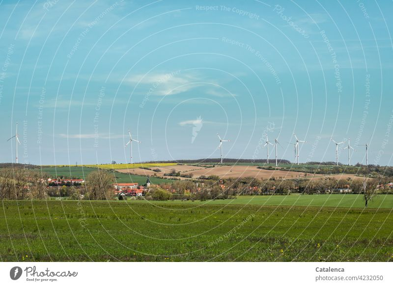 Lovely, slightly hilly landscape, with village, fields, forest and windmills on a beautiful spring day Nature Landshaft Forest Village Wind energy plant Energy