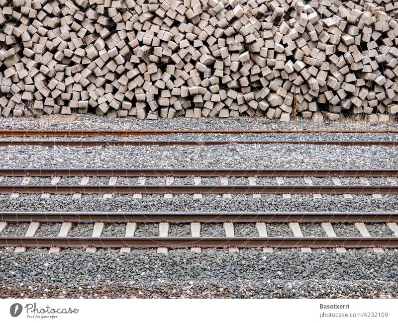 Railway tracks with stacked concrete railway sleepers in the background Track railway tracks Sleepers Stack Heap Transport Railroad Railroad tracks rails