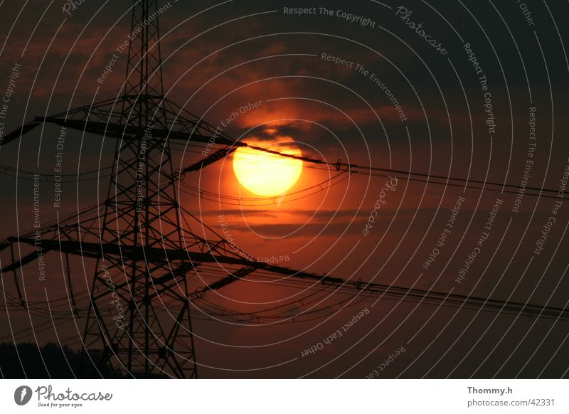 Energy in the double sense Electricity Sunset energy Electricity pylon Evening