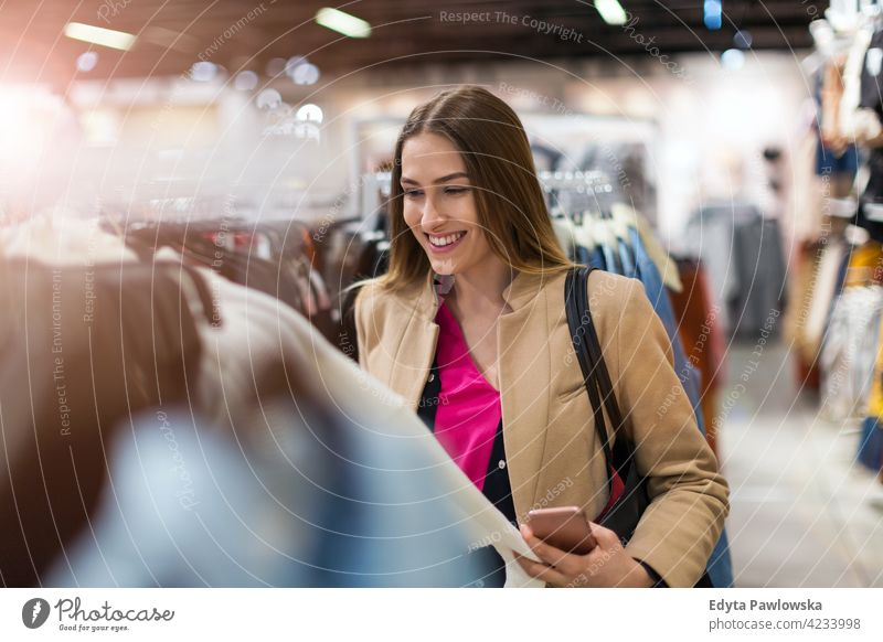 Portrait of young woman in shopping mall enjoying lifestyle adult people one person casual caucasian positive carefree standing happy smile smiling female