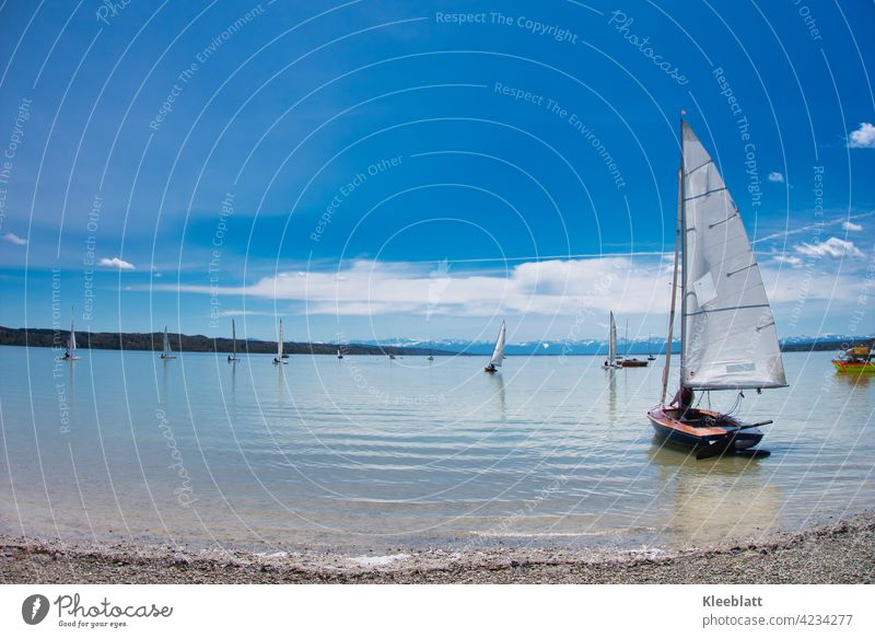 Sailing boats are launched on the Ammersee - time out and relaxation in beautiful spring weather Sailboat sailboats Water mountains Sky Blue cautious clouds