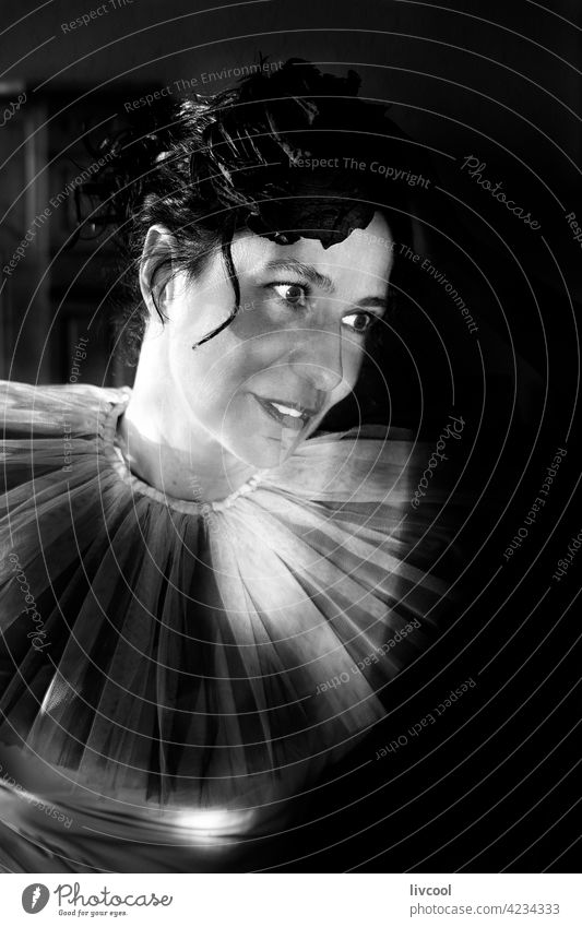 woman in darkness IV face tulle romantic attitude tulle collar light and shadow seat black and white interior portrait smile happy home nostalgic style allure