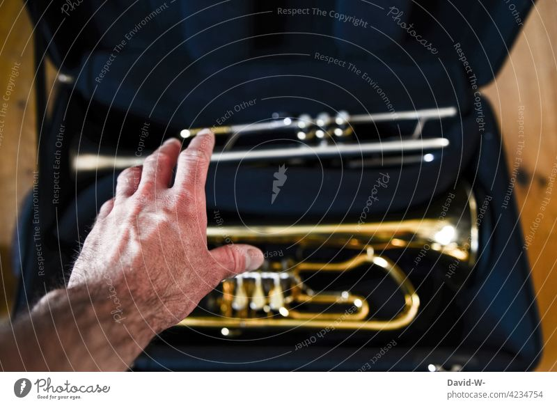 Discipline and ambition - musician with instrument Hand Musician discipline Musical instrument Trumpet diligence Ambitious Preparation Grasp self-study