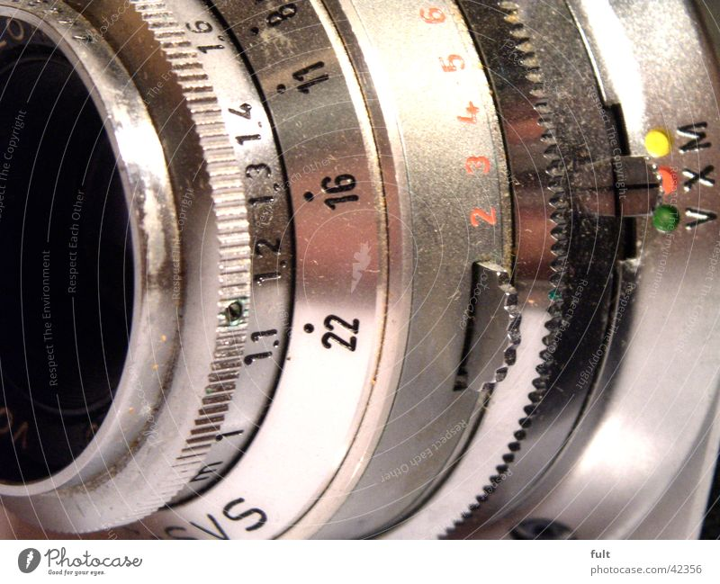 camera Digits and numbers Round Relief Gray Red Green Yellow Entertainment Camera Objective Settings Furrow Metal Point Lens Signs and labeling