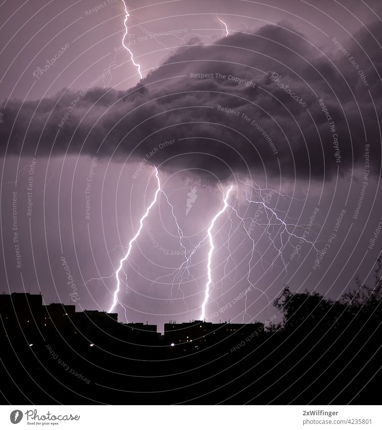 Thunderstorm over the city in summer night thunder thunderbolt thunderstorm weather Ozon Vienna air anxiety atmosphere august backlight bad bright capital
