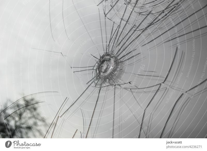 Glass breakage, trace left by hard impact Pane Crack & Rip & Tear Abstract Damage Vandalism Aggression Shop window Case of damage glass break Detail Broken