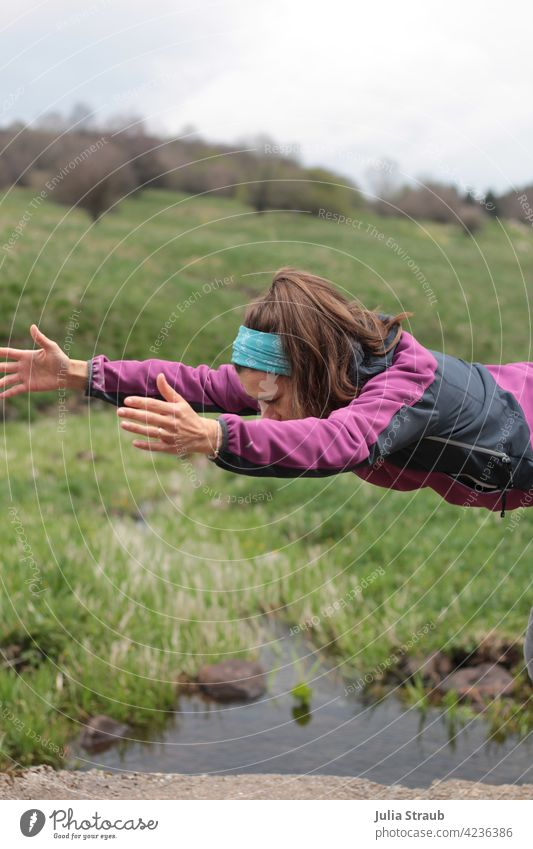 Flying through space and time Yoga Half-profile truncated long hairs Brunette Woman be out Nature Rhön Nature reserve Water bachlauf Meadow Grass Green spring