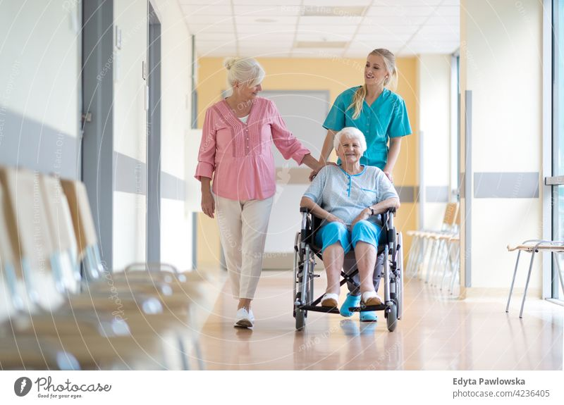Elderly woman on wheelchair with her daughter and nurse wheel chair disability physical impairment Handicapped mobility support accessibility object handicap