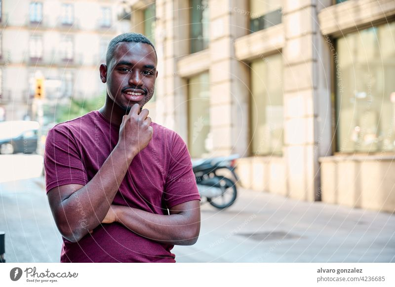 young african american model looking directly to camera male black adult portrait handsome casual attractive che person expression people guy one confident cool