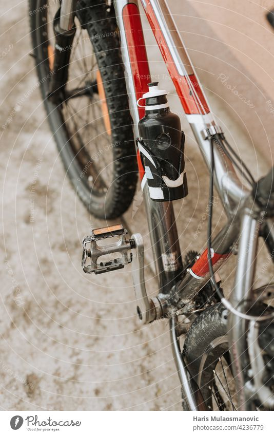 dirty bicycle with water bottle background bike biking black business chain closeup cyclist equipment gear industrial industry lifestyle looking maintenance man