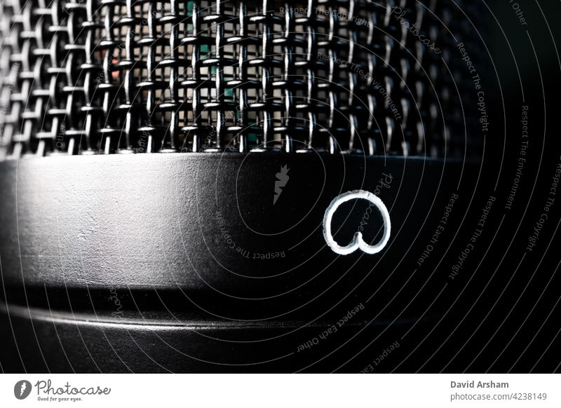 Macro Closeup of Large Diaphragm Condenser Microphone Cardioid Polarity Symbol and Grill microphone large diaphragm condenser condenser microphone recording