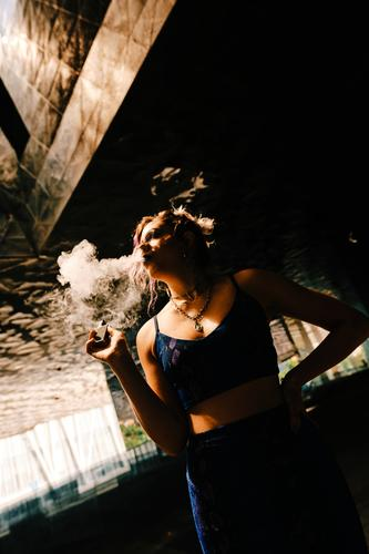 a girl using a vaporizer to eliminate tobacco addiction smoking sensual aspirations smoky smoke smoker alternative woman portrait electronic cigarette beauty
