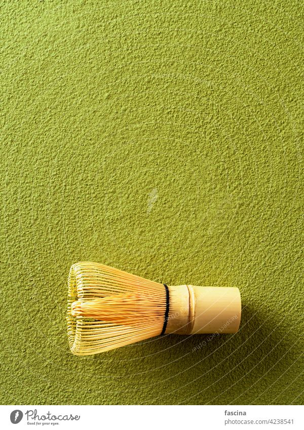Powdered green tea Matcha and bamboo whisk white matcha background copy space top view vertical ceremony wooden chasen lifestyle traditional asian powder design