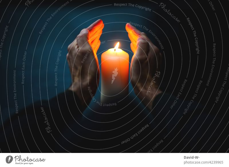 Warming hands on a candle shoulder stand warm sb./sth. Candlelight Cold Winter Candle flame Christmas & Advent Burn Illuminate Grief