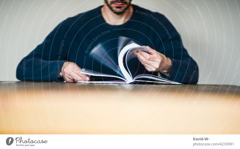 Man leafing through a book Book To leaf (through a book) lookup Reading Education Study Table Sit Anonymous book pages Know