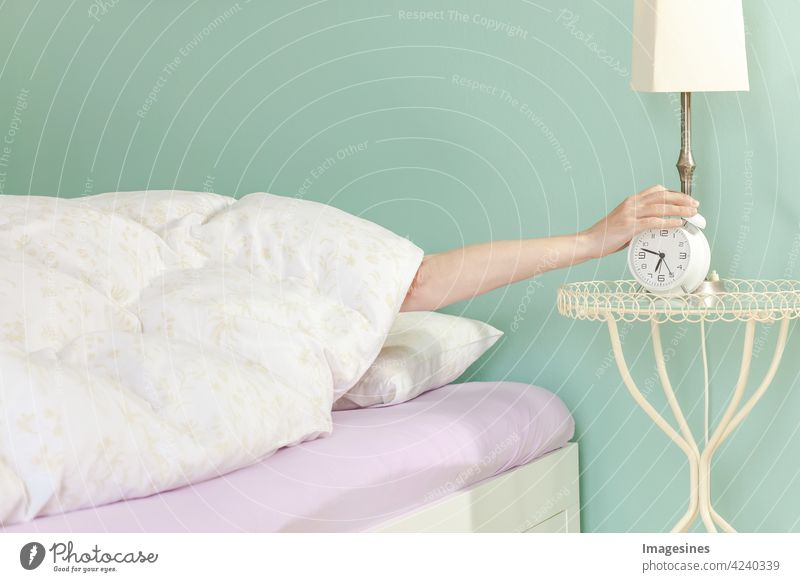 Good morning, get up! Turn off the alarm clock. Sleep concept wake up Arise Alarm clock Switch off Wake up more adult Watchfulness Flat (apartment) Bed