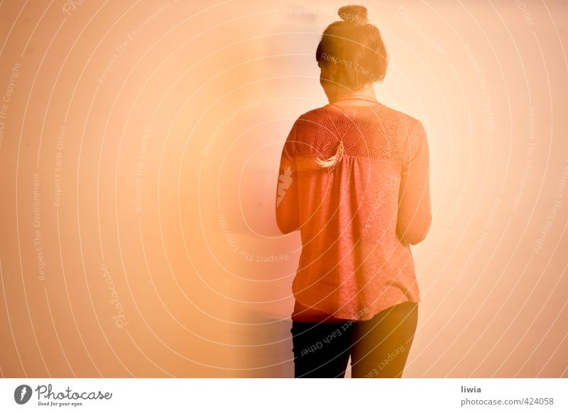 matilda Feminine 1 Human being Sweater Contentment Metal coil Hair and hairstyles Chignon Long exposure Rear view Colour photo Studio shot Motion blur