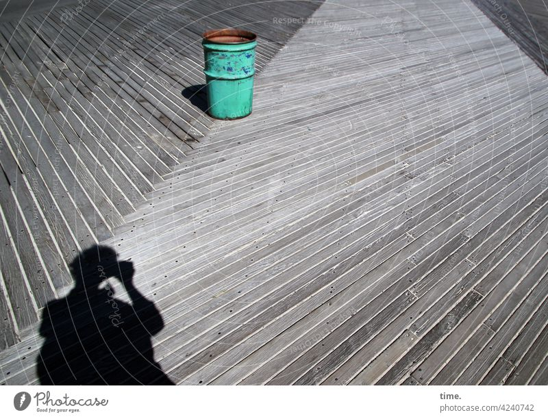 Garbage can on wooden path rubbish clay Photographer Shadow Silhouette Take a photo wooden planks Woodway Diagonal sunny Whimsical green