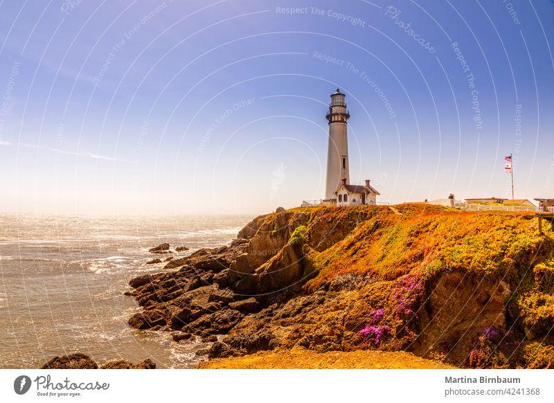 The Pigeon Point Lighthouse on the coast of California pacific pigeon point lighthouse architecture beach beacon beam blue building california coastline