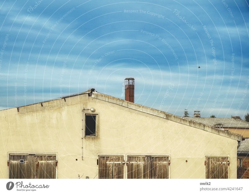 Old LPG Building Wall (building) Facade Low building Window Sky Clouds dreariness Exterior shot Architecture Gloomy Wall (barrier) Deserted Manmade structures