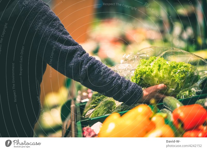 Food - Woman shopping in the vegetable department Vegetable Shopping Products plastic Plastic packaging Hand Store premises salubriously Supermarket Customer