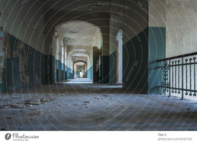 a long corridor in which time has stood still Hallway empty Ruin Derelict door Old Corridor Light Building Broken inspire Transience Colour Architecture