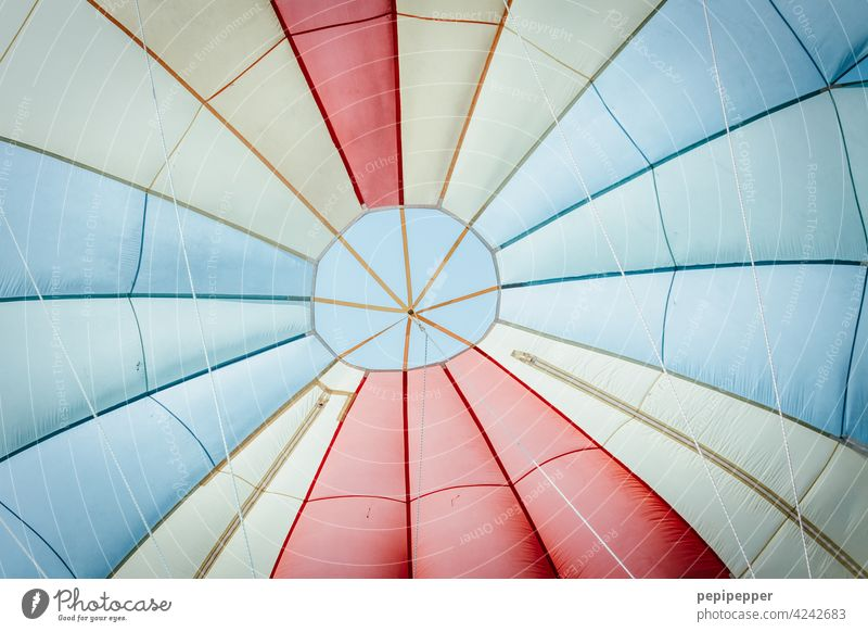 Parachute photographed from below Skydiving Skydiver To fall plummeting plumped parachute silk Flying Freedom Jump Joy Sports Air Thrill Blue variegated motley