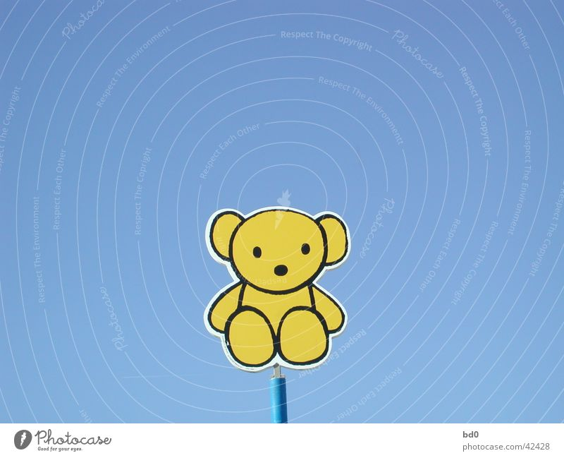 Yellow Signs and labeling Illustration Blue sky Bear Cuddly toy Teddy bear Symbols and metaphors Color gradient