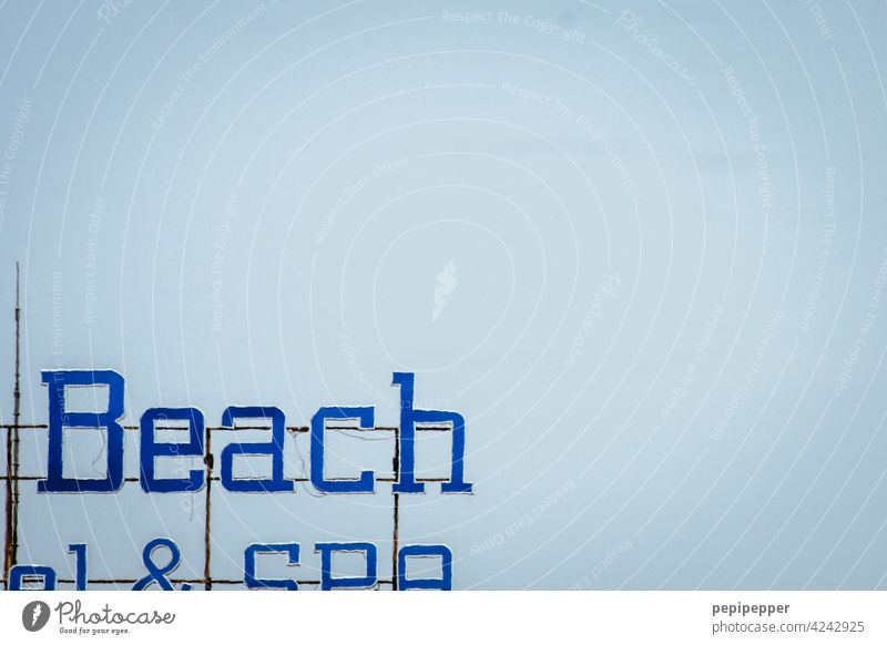 beach Beach Signs and labeling sign Hotel Hotel sign Signage Deserted Clue Characters Letters (alphabet) Typography Word Colour photo Communication Communicate