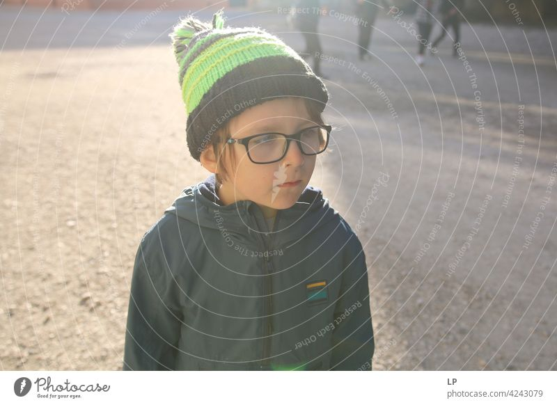 portrait of a child wearing a hat and glasses difficulties empathy challenge Complex need soothing Behavior coping with social distancing Well-being Stress