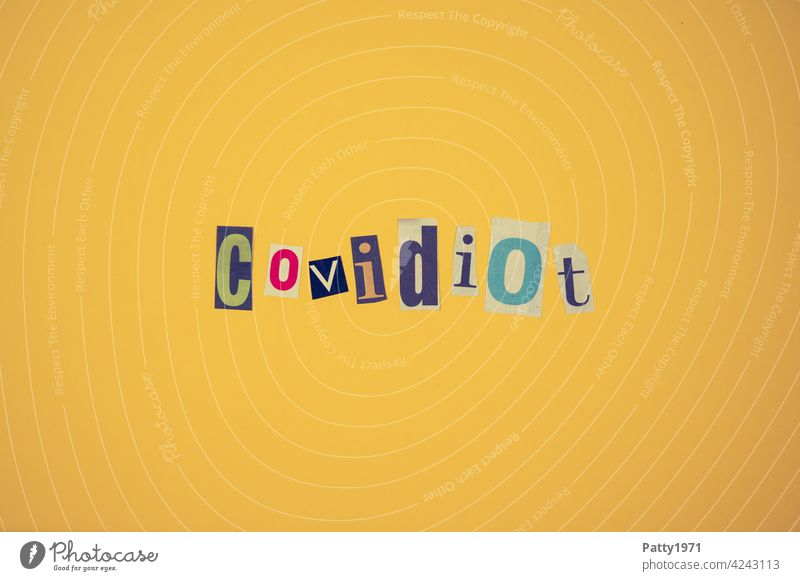 Cut out newspaper letters form the word Covidiot   corona thoughts pandemic Collage Corona denier opponent coronavirus Healthy Risk of infection