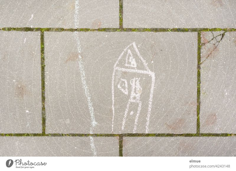 On the pavement slabs a child has painted a house and a path with white chalk / creativity House (Residential Structure) Children's drawing Stone slab