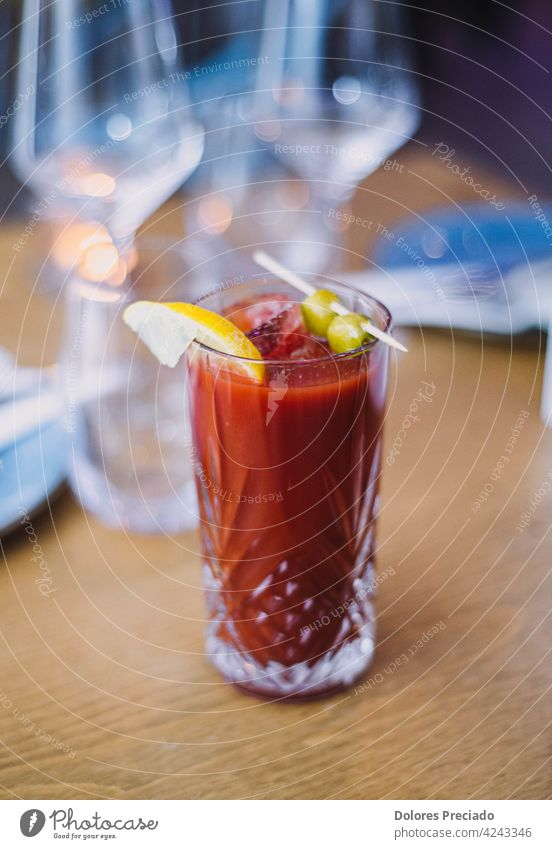 Bloody Mary cocktail on the table of a European restaurant alcohol alcoholic background bar beverage bloody bloody mary bloody mary drink bokeh brunch cocktails