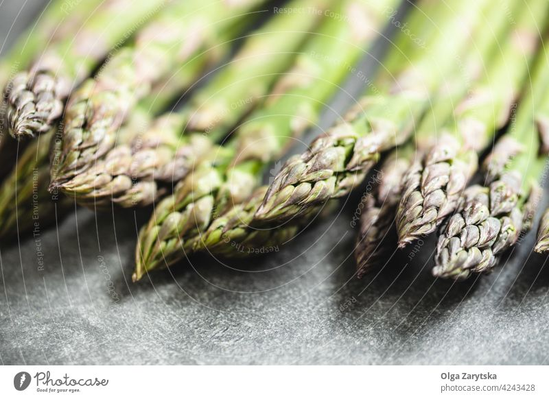 Fresh asparagus on table. green fresh food gray selective focus close up vegetable healthy raw organic steam tied vegetarian seasonal background