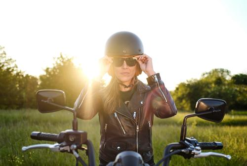 woman on motorcycle wearing sunglasses person motorbike road female outdoor travel biker lifestyle beautiful transportation girl young adult vehicle jacket