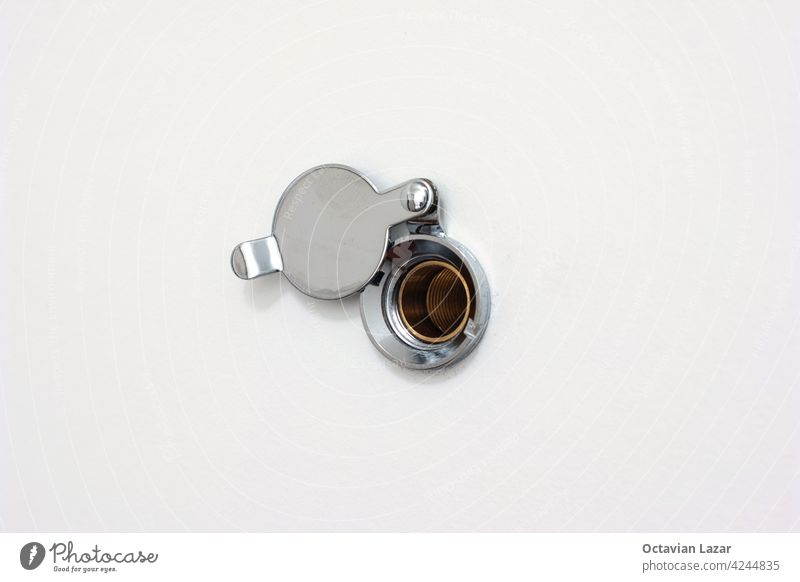 Home door peephole with metal lid cover white wood background macro close up shot fish-eye home vigilance eyewitness eyelet access metallic curiosity privacy
