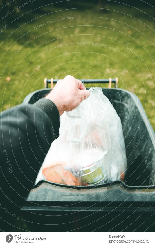 Man throws garbage in the trash can Trash dustbin Dispose of waste Throw away Waste management plastic waste yellow ton Arrangement Hand