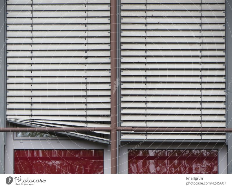 Double glazed window with the external blinds down, one has snagged Venetian blinds Window Screening broken Aluminium Aluminium blind Protection
