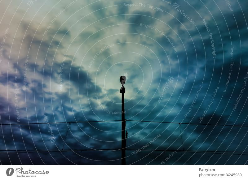 street lamp in front of the dramatic sky Art Contrast Glittering Dark Light (Natural Phenomenon) Esthetic Abstract enlightenment lamps Aesthetics Winter mood