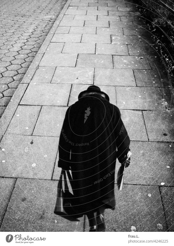 detour Grief Photomontage on one's own Human being Sadness sad Lonely Loneliness Crooked Coat Handbag Hat Going Woman Footpath