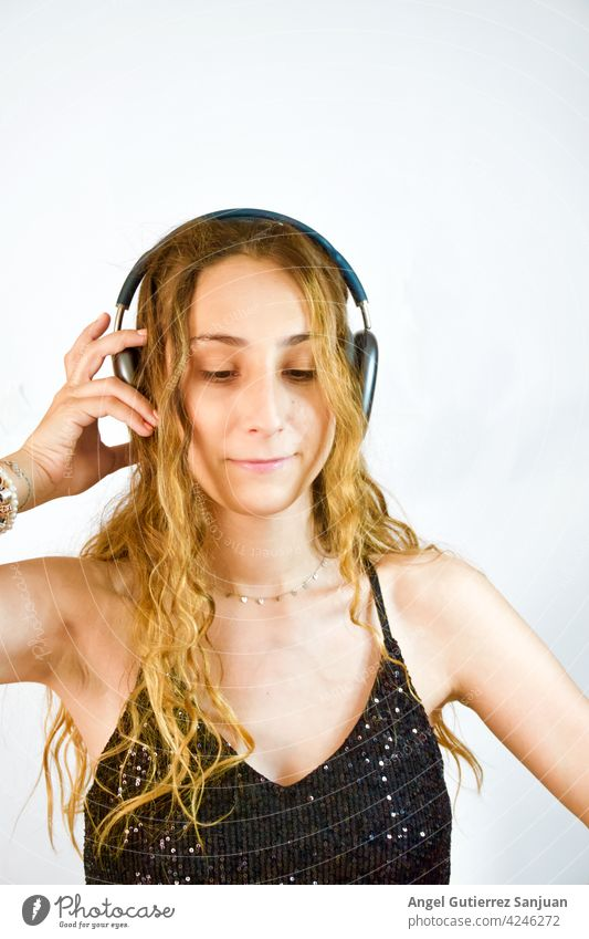 woman listening to music with headphones on white background Headphones Music Listen to music Woman Lifestyle Listening White Leisure and hobbies