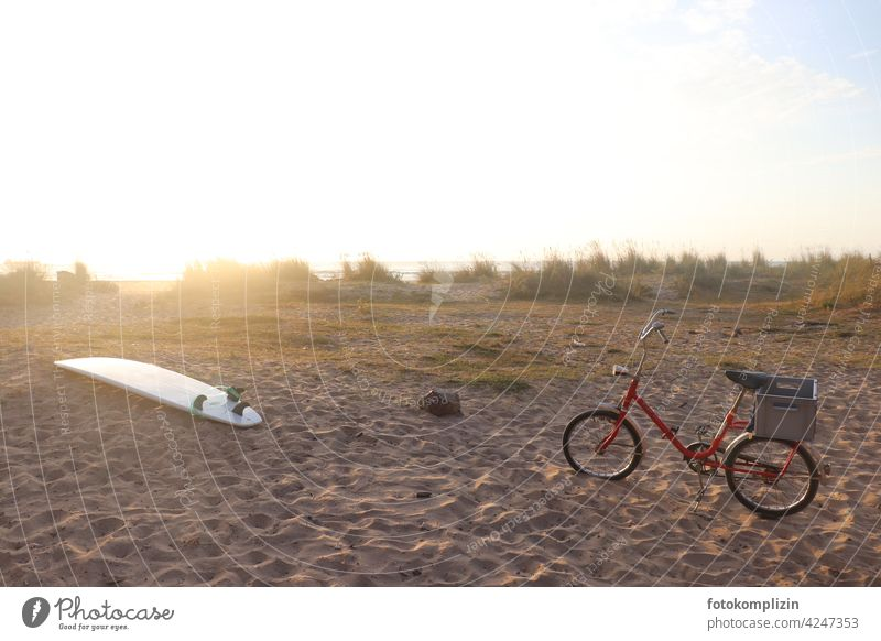 Surfboard and red folding bike on the beach Surfing Aquatics Beach Folding bicycle Wheel Bicycle Movement Leisure and hobbies Vacation & Travel Summer Ocean