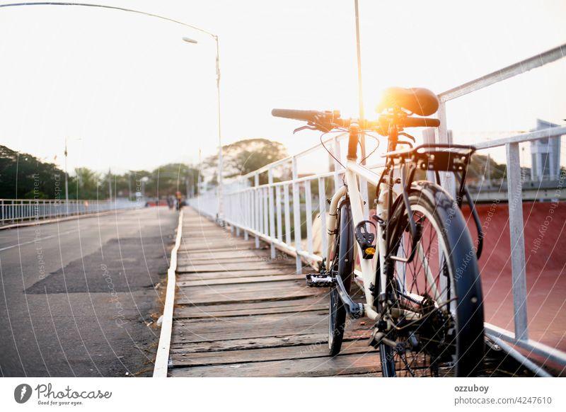 bicycle parking on side bridge Bicycle Parking Bridge Bridge railing transportation bike outdoor urban lifestyle city summer vehicle riding vintage wheel road