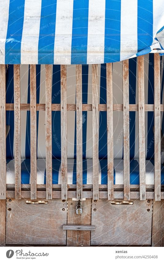 Closed beach chair, striped in blue and white Beach chair vacation Vacation & Travel Ocean Sand Summer coast Relaxation Blue White Striped closed locked
