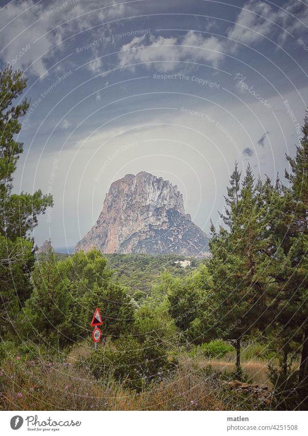 Slope 12 % Incline Landscape mountain Cliff Forest street sign Ocean Sky Beautiful weather Ibiza isla de es vedra